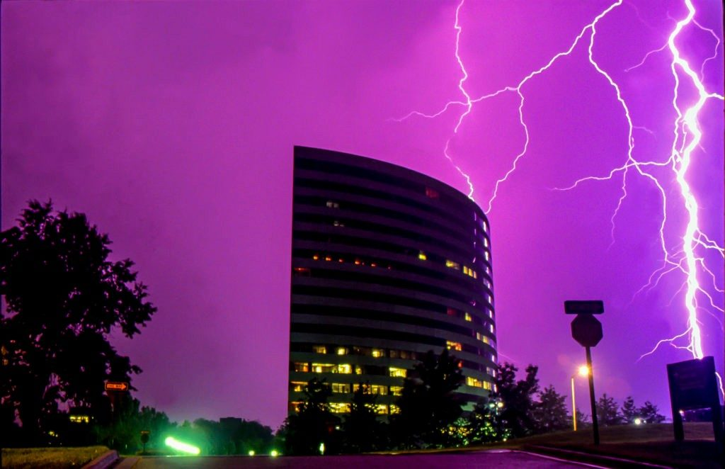 An intense thunder storm turns the sky purple and creates spectatular lightning displays over Corporate Woods office center, Overland Park, Kansas.